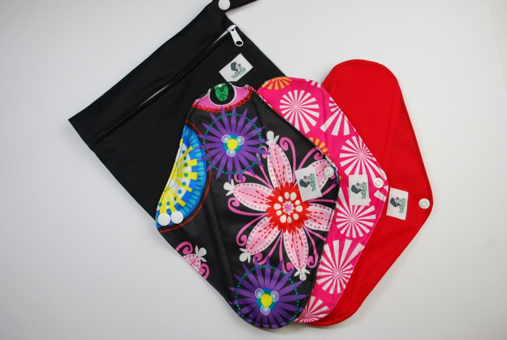 3 Reusable sanitary pads black, pink and red